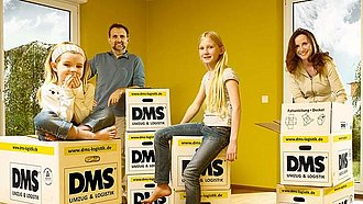 Family with children are sitting on packed moving boxes during their private move